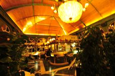 The Restaurante Las Titas, a popular sidewalk restaurant along the river on Granada's Paseo del Salon, was rebuilt a few years in this fantastic mode. It's an appealing stop at any time of day or night.