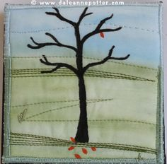 Autumn Tree #3 - 4 inch square by Dale Anne Potter.  Hand coloured fabric, hand drawn tree, machine stitched.