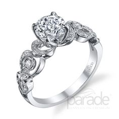 from Parade Design Meandering vines play up to a brilliant cut diamond.