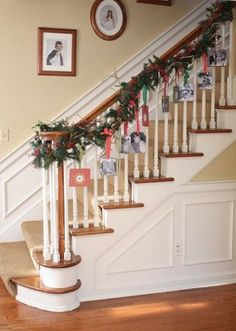 Display and Store Your Holiday Cards- Take a Trip Down Memory Lane: Sarah of Clover Lane used the cards to adorn her staircase. She added decorative paper and the year of each card to its back, and her kids got to take a fun trip down memory lane every time they went up or downstairs. Source: Clover Lane christma card, christmas cards, holiday cards, family photos, card displays, photo ornaments, christmas ornaments, garland, christmas photos