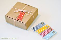 A little bakers twine, fabric backed kraft card stock, an oversized eyelet and you have one cute package decoration or gift tag.