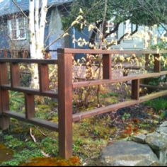 Attractive idea for future front yard fencing, we'd just add chicken wire for the girls to be able to run up front!