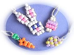 This site has the cutest beadie patterns and its free. Instead of pony beads I use 28 guage wire and delica beads.. they make darling charms