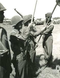 US 5th Army Lt. Gen. Mark Clark pinning Presidential Distinguished Unit Citation ribbons to Japanese-American members of 100th Infantry Battalion, Vada area, Italy, 27 July 1944. (US Army Signal Corps)