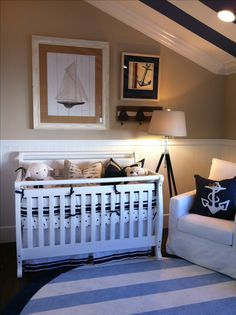 khaki wall, navy bedding, baby blue rug