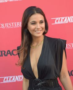 Emmanuelle Chriqui braless in a plunging black dress