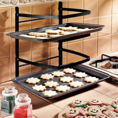 Folding Baker's Rack. Great for limited counter space. This foldable rack holds four cookie sheets! genius!