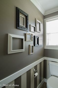 Half Bath... Love the molding strip with wallpaper and paint
