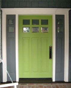 Grey exterior. White trim. Green door.