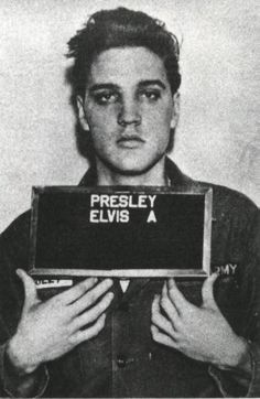Elvis Presley mugshot after he was arrested for assault in 1956.
