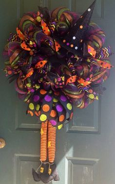 A Witch Mesh Wreath with Witch's Hat and Legs.  Polka-dot and Chevron Ribbon