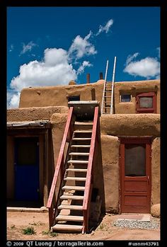 Ladder used to access upper floor of pueblo. Taos, New Mexico, USA - photography of QT Luong