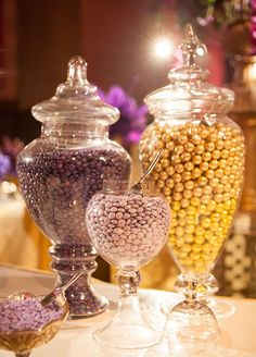 The candies are matching the purple and gold theme color of this wedding.
