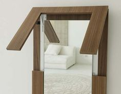 folding dining table transformers into a mirror from porada 3