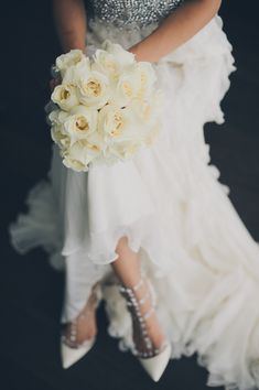Beautiful Bouquet, dress, and #valentinos. perfection.