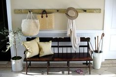 Bench with Hanging Rack Above & Umbrella Stand. Off White, Light Yellow, & Cremes (Scott Sanders)