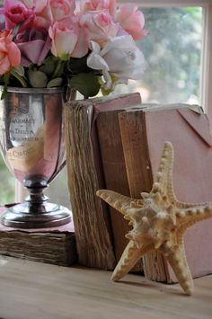 books, starfish and flowers vignette -- so pretty --  pink bathrooms, pink roses, cottag, vignett, starfish, beach house decor, sea, antique books, old books