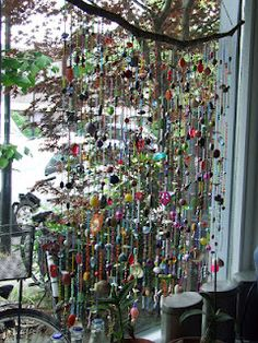 Suncatcher / window hanger with a lot of beads and shells bead, window hanger