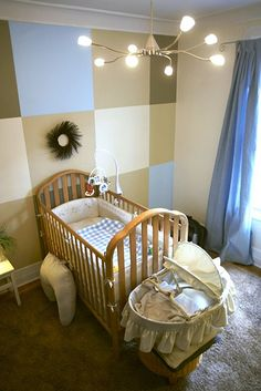 I so like this... And my walls in the nursery are already that creamish beige color on the window wall.... I wonder how I could make the squares on that one focus wall... The colors will go great with his teddy bear theme