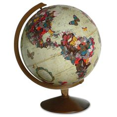 ImagineNations vintage globe art, featuring a stunning arrangement of butterflies shaping the world's continents and migrating in between them butterfli globe, globe art, butterfli shape, globe project