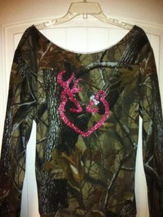 This listing is for a camo slouchy sweatshirt ... The color of the logo is glitter pink with a silver bow ... Sizes S-XL available this slouchy is