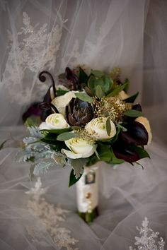 White rose and succulent #bouquet | Ashley Therese Photography | Brides.com