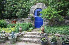 Blue garden gate in stone arch