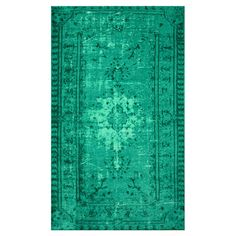 Bring eye-catching appeal to your den or define areas in the living room with this overdyed rug, showcasing a Persian-inspired motif in turquoise.