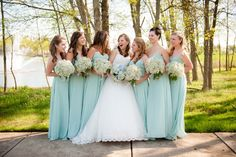 Seafoam floor-length bridesmaids dresses with baby's breath bouquets. From Chris & Vida's beautifully simplistic, teal & sea foam green, springtime wedding in Northern Virginia. Images by Kelly Ewell Photography. seafoam green wedding, color palettes, sea green wedding, bridesmaid dresses, bridesmaid colors, the dress, sea foam green dress, bridesmaid bouquets, seafoam bridesmaid dress