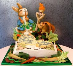 Rosebud cakes  More Vegetables !    Peter Rabbit in the Garden    Mr. MacGregor's garden comes alive when story-book format becomes more than a pop-up. Buttercream characters interact with 3-D white chocolate terra cotta pots and vegetables that make you forget all about the consequences of transgression!