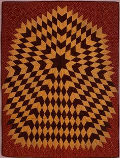 Starburst crib quilt circa 1880-1890. From the collection of the American Folk Art Museum.