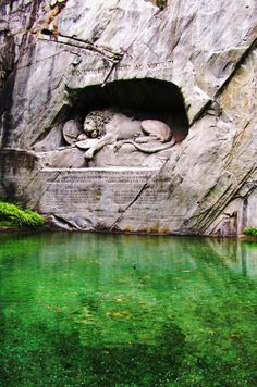 The Dying Lion, a sculpture in Lucerne, Switzerland created in honor of the Swiss Guards who died defending King Louis XVI, Marie Antoinette, and their children during the French revolution. My favorite of all sculptures...so moving. Look at his face.