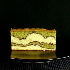 Fantasy cake with Matcha- alternate between green and white batter, each layer topped with sifted cocoa powder.