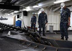 PACIFIC OCEAN (Sept. 6, 2013) Lt. Cmdr. Steven Reynolds, right, from Antioch, Calif., observes the raising of an anchor chain during a drop test aboard the aircraft carrier USS Ronald Reagan (CVN 76).