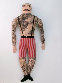 the tattoo-ed man doll