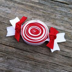 Red and White Christmas Peppermint Wrapped Candy Ribbon Sculpture Hair Clip Bow.. Free Shipping Promo.  via Etsy.