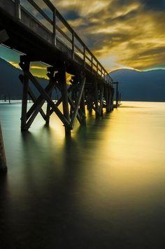 Peaceful ..... thoughtful .... romantic .... beautiful. Sunset, sunrise, water, reflections, golden, clouds, bridge, breathtaking view, photo.