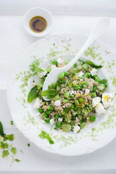 Quinoa salad with peas, favas, feta mint and lemon