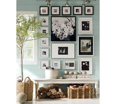 Black  White Photos, Art in black or white frames on an aqua blue wall. from Pottery Barn
