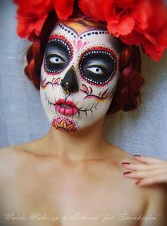 Sugar skull Halloween or Day of the Dead makeup.  Day of the Dead (Spanish: Día de Muertos) is a holiday celebrated particularly throughout Mexico (where it is a national holiday, and all banks are closed) and also around the world. The holiday focuses on remembering friends and family members who have died. The celebration takes place on November 1 and 2, in connection with All Saints' Day and All Souls' Day.