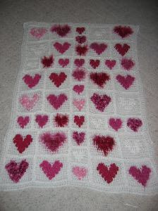We love the varied textures and shades of this Hearts Of Many Yarns Afghan. If you have a lot of scrap yarn, this is a good way to use different kinds of yarn to make one afghan.