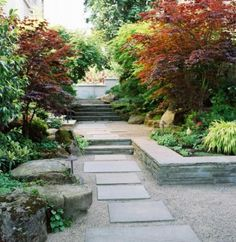 """Rectangular granite stepping stones and gray gravel create an informal entry and a permeable path."" - Lauren Bonar Swezey; landscape by Ron Herman Landscape Architect"
