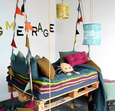 Colorful swing bed for kids :: on Handmade Charlotte  great idea, but, much lower to the ground...... maybe even better in a playroom.... not as a bed.