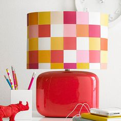 Dress up your lamp shade with paint chips! More DIY lamp updates: http://www.bhg.com/decorating/do-it-yourself/accents/diy-lamp-projects/?socsrc=bhgpin091213squaredofflamp&page=5