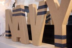 CUTE & INEXPENSIVE child or last name decor IDEA! Get cardboard letters from craft store and add washi tape! Via Kara's Party Ideas   KarasPartyIdeas.com