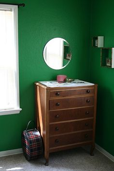 I was gonna paint the dresser black but the red tint of the wood looked so pretty against the green.