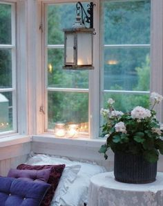 Window seat with a view and candlelight.