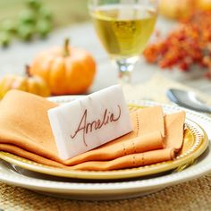 Use a simple tiles as your place cards when you're setting the table. Write a guest's name on the tile using a permanent marker for place cards you'll use once, or use a dry-erase marker for reusable place cards.