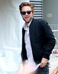 Robert Pattinson — whose latest girlfriend is buzzed-about singer-songwriter FKA Twigs — strolls the streets of Toronto, where he's promoting his new flick Map to the Stars at the city's film festival