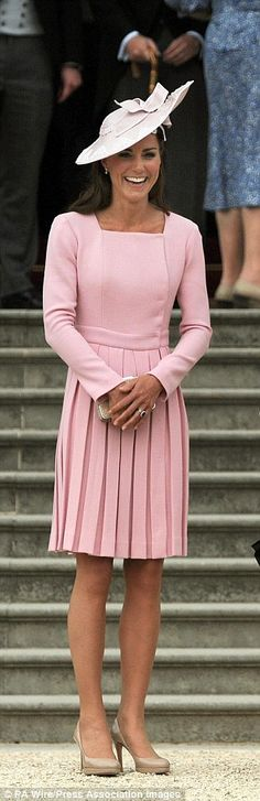 Pretty in pink: Kate's pleated pink dress and matching hat was a hit at a garden party at Buckingham Palace...What if we DO get to see some Royals!!!